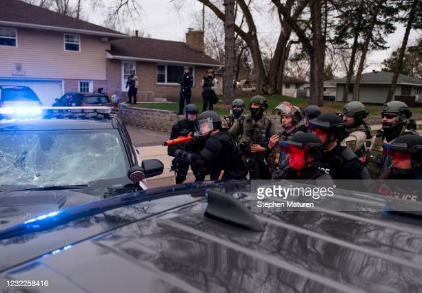 Police officer shoots a weapon, striking a man in the neck, as people gathered to protest on April 11, 2021 in Brooklyn Center, Minnesota. Earlier...