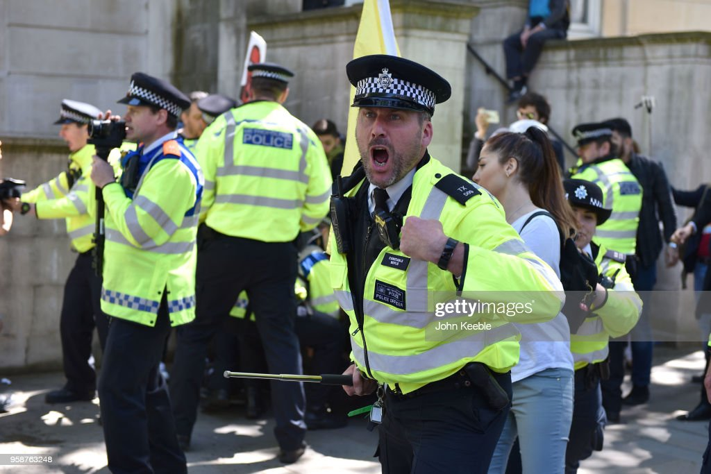 A Police officer shouts instructions at Anti-Erdogan protesters as they clash outside Downing Street as Turkish President Recep Tayyip Erdogan meets the Prime Minister, on May 15, 2018 in London, England. Turkish President Mr Erdogan is in the UK for a three-day visit, which includes a closing lecture at the Tatlidil Forum in Oxford, an audience with The Queen and talks with British Prime Minister Theresa May.