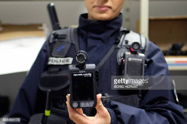 A police officer shows a body camera on February 15 2017 in Marseille Currently in Marseille only the Mountain bike brigade of the city center and...