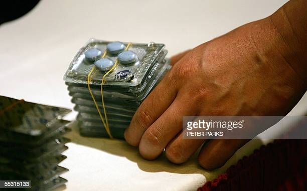 A police officer shows fake Viagra that was seized in raids at a press conference in Beijing 08 September 2005 China and the United States have...