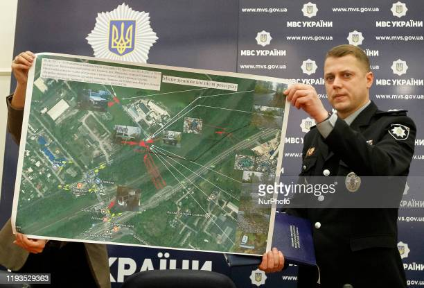 A police officer shows for journalists a map of the site where Amina Okuyeva was shot dead during a pressbriefing about the results of the...
