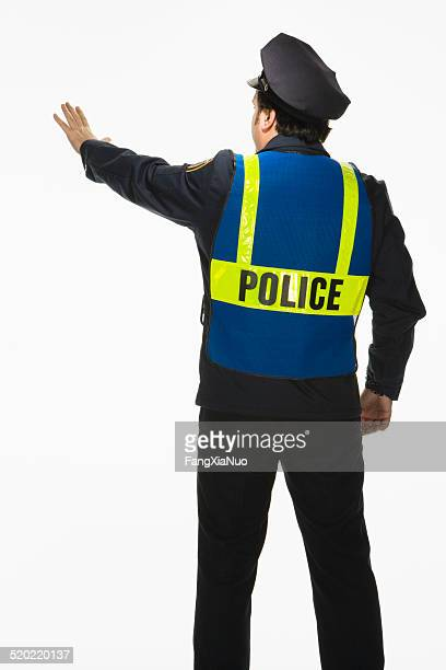 Police officer signally stop on white background