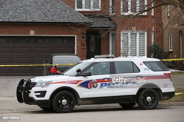 A police officer sits in a crusier outside Alek Minassian's house in Richmond Hill Ontario on April 24 2018 A van driver who ran over 10 people when...