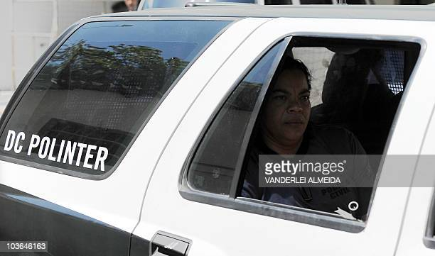 A police officer sits on the vehicle transporting the former goalkeeper and captain of the Brazilian football team Flamengo Bruno de Souza as they...