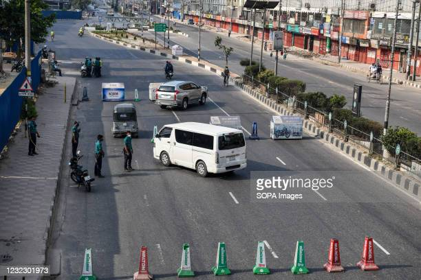 Police officer speaks to a driver at a checkpoint in Banani. Police checkpoints are set up in various places in the capital to stop the unnecessary...
