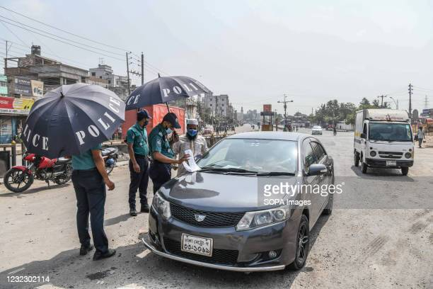 Police officer speaks to a driver at a checkpoint in Gabtoli. Police checkpoints are set up in various places in the capital to stop the unnecessary...