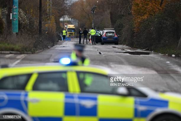 Police officer staffs a cordon as investigators work at a waste water treatment plant in Avonmouth, near Bristol in southwest England on December 4,...