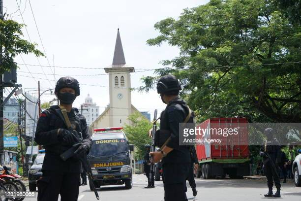Police officer stand guard in the front of Makassar Cathedral Church after a suicide bomb attack in Makassar, South Sulawesi province, Indonesia on...