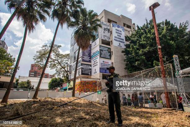 A police officer stand guard outside the Monaco building in Medellin Colombia which was once home to Colombian drug lord Pablo Escobar during the...