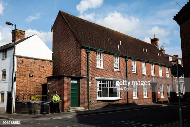 A police officer stands at a cordon around a public litter bin next to a supported housing project in Salisbury thought to be connected to a man and...