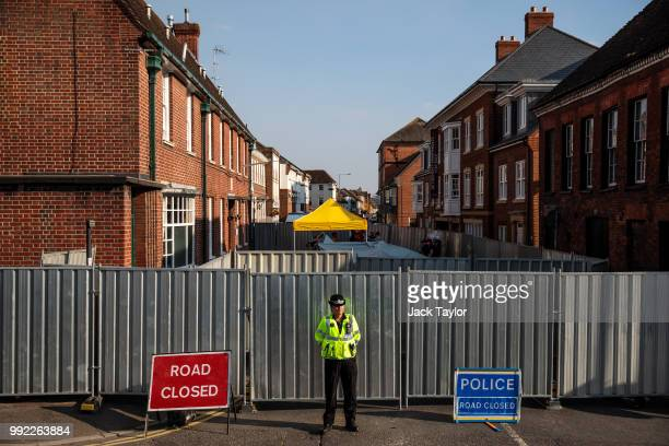 A police officer stands at a cordon around a supported housing project in Salisbury after a major incident was declared when a man and woman were...