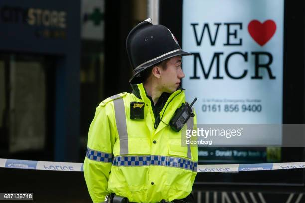 A police officer stands at a cordon following an evacuation at the Arndale shopping mall in Manchester UK on Tuesday May 23 2017 At least 22 people...