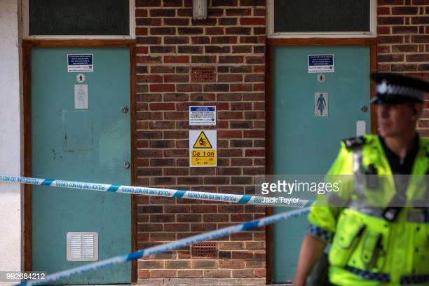 A police officer stands at a cordon in place around male and female public toilets at Queen Elizabeth Gardens in Salisbury after a major incident was...