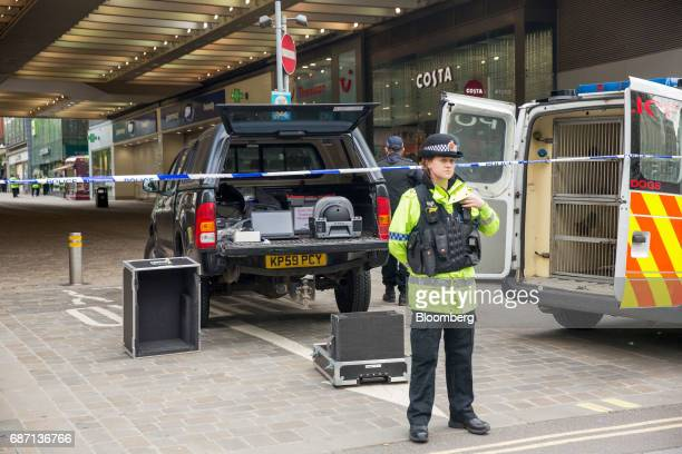 A police officer stands at a cordon near to a bomb disposal equipment following an evacuation at the Arndale shopping mall in Manchester UK on...