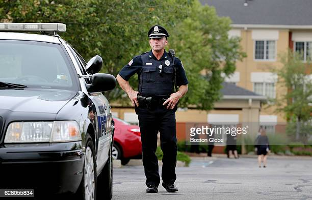 A police officer stands at the entrance to the Extended Stay America hotel in Burlington MA on Jul 2 2015 Police were investigating a body found in...