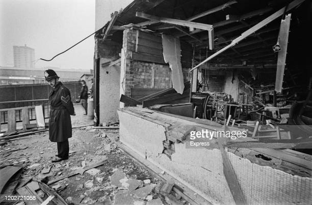 Police officer stands before the damage caused by one of the two pub bombings which hit the city on 21st November 1974, in Birmingham, West Midlands,...
