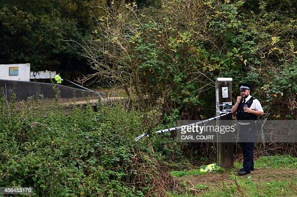 A police officer stands by a cordon at the scene where a body was found during the search for missing schoolgirl Alice Gross in west London on...
