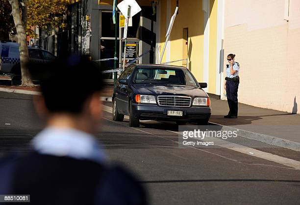 Police officer stands by the car of underworld figure Desmond 'Tuppence' Moran who was shot dead earlier today at Ascot Vale on June 15 2009 in...