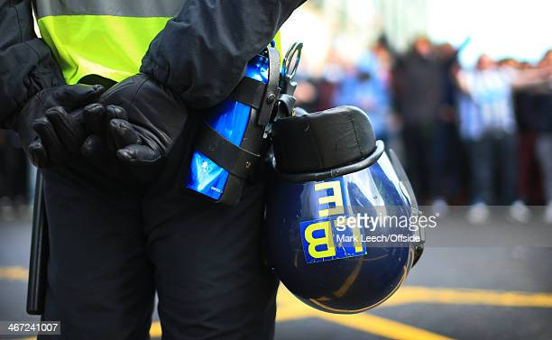 A police officer stands by with a his riot helmet prior to the Barclays Premier League match between Newcastle United and Sunderland at St James'...