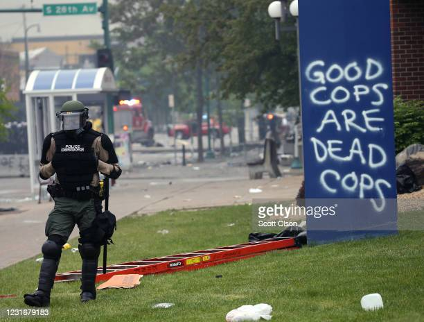 A police officer stands gaurd on the fourth day of protests on May 29 2020 in Minneapolis Minnesota The National Guard has been activated as protests...