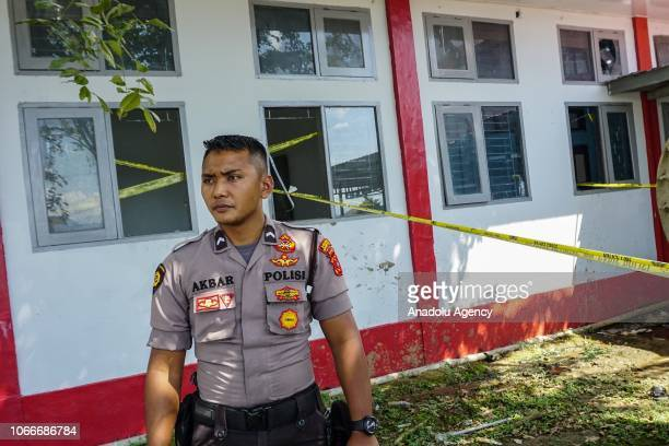 A police officer stands guard around the Class IIA Penitentiary in Lambaro Aceh Besar Aceh Indonesia on November 30 2018 At least 113 inmates escaped...