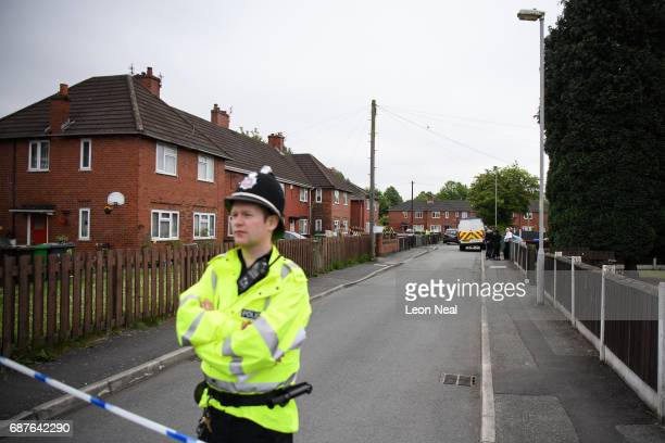 A police officer stands guard as forensic teams search the former home of terrorist Salman Abedi on May 24 2017 in Manchester England An explosion...
