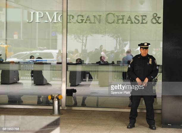 Police officer stands guard as people protest outside of the New York City headquarters of JPMorgan Chase on May 11, 2017 in New York City. JPMorgan...