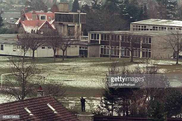 A police officer stands guard at Dunblane primary school Scotland shortly after the shooting incident on the premises The Dunblane school massacre...