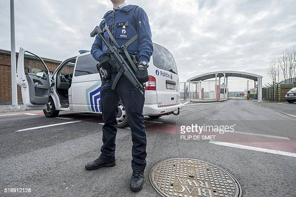 TOPSHOT A police officer stands guard at the entrance of Brussels Airport in Zaventem on March 22 after at least 13 people have been killed by two...