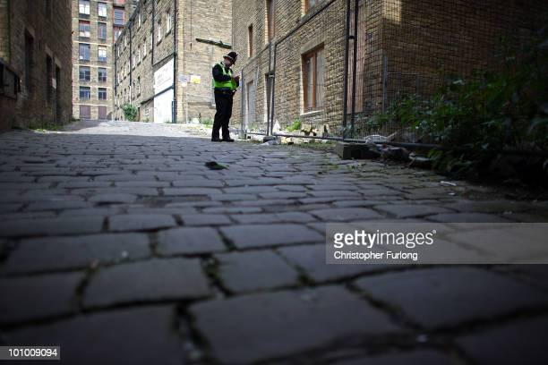 A police officer stands guard at the rear of the property of a man arrested on suspicion of murder on May 27 2010 in Bradford England West Yorkshire...