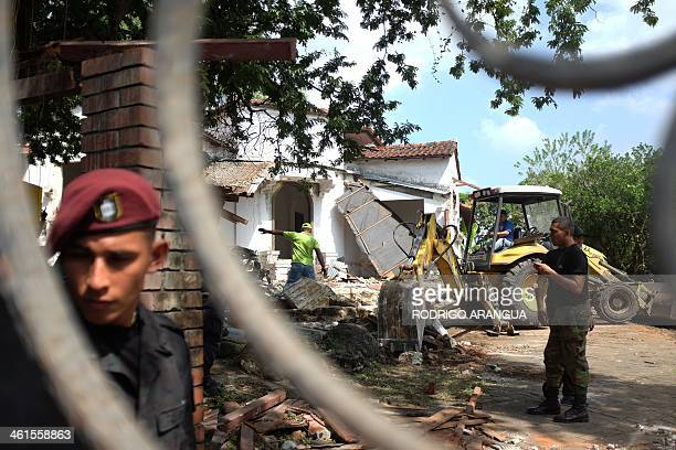 A police officer stands guard at the residence of Panama's former dictador Manuel Antonio Noriega currently imprisoned in Panama in Panama City as it...