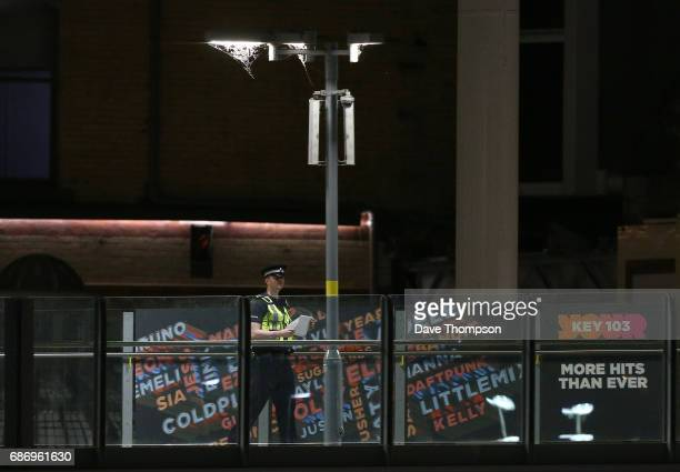 A police officer stands guard at Victoria Railway Station close to the Manchester Arena on May 23 2017 in Manchester England An explosion occurred at...