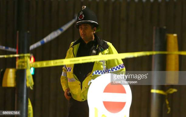 A police officer stands guard close to the Manchester Arena on May 23 2017 in Manchester England An explosion occurred at Manchester Arena as concert...