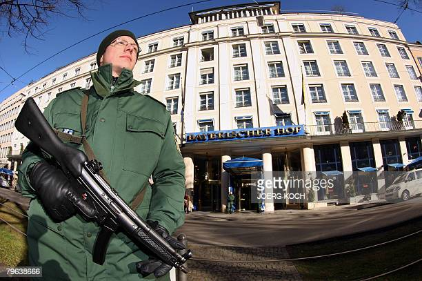 A police officer stands guard in front of the Hotel Bayerischer Hof on February 8 2008 in Munich southern Germany where preparations are under way...