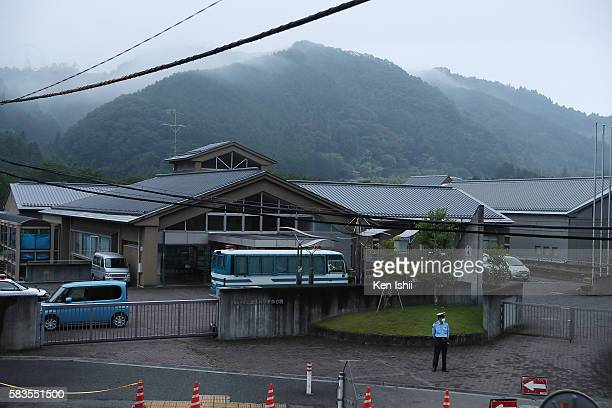 Police officer stands guard in front of Tsukui Yamayuri En care home on July 27, 2016 in Sagamihara, Japan. A man who claimed he wanted to kill...