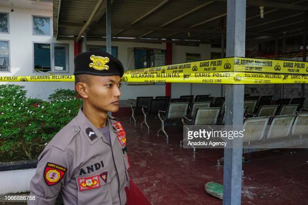 A police officer stands guard in the Class IIA Penitentiary in Lambaro Aceh Besar Aceh Indonesia on November 30 2018 At least 113 inmates escaped...