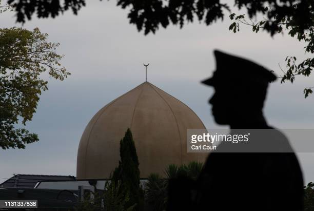 A police officer stands guard near Al Noor mosque on March 18 2019 in Christchurch New Zealand 50 people were killed and dozens are still injured in...