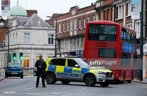 A police officer stands guard near to the scene where a man was shot and killed by armed police on February 2 2020 in London England The Metropolitan...