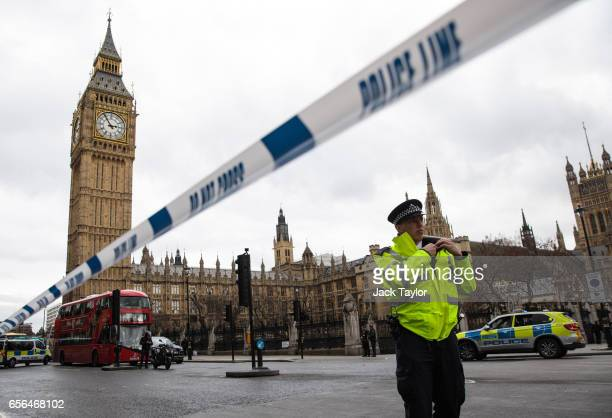 A police officer stands guard near Westminster Bridge and the Houses of Parliament on March 22 2017 in London England A police officer has been...