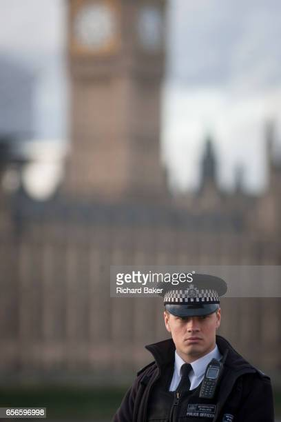 Police officer stands guard opposite the Houses of Parliament after our people were killed and 20 injured during a terrorist attack on Westminster...