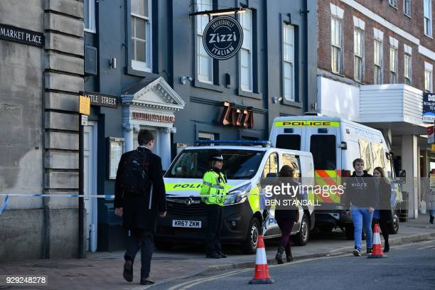 A police officer stands guard outside a cordonedoff branch of the Italian chain restaurant Zizzi close to The Maltings shopping centre in Salisbury...