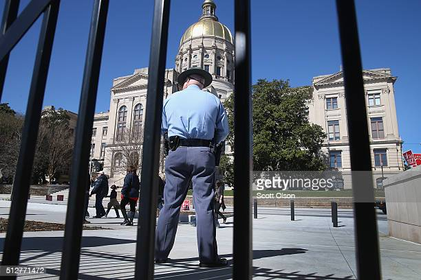 A police officer stands guard outside a rally where Republican presidential candidate Sen Ted Cruz was speaking to supporters across from the state...