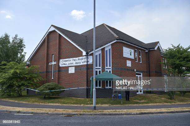 A police officer stands guard outside Amesbury Baptist Centre in Amesbury southern England on July 7 2018 The exposure of an apparently random...