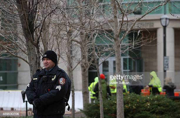 A police officer stands guard outside of the Buzz Westfall Justice Center on November 24 2014 in Clayton Missouri A St Louis County grand jury has...