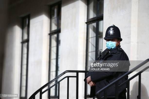 Police officer stands guard outside the King Edward VII's Hospital, in central London on March 5 where Britain's Prince Philip, Duke of Edinburgh has...