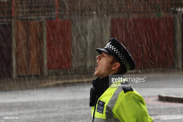 A police officer stands in a hail storm close to a crime scene where a Soldier from Wellington Barracks was killed yesterday on May 23 2013 in London...