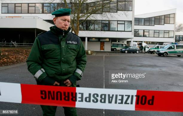 A police officer stands in front of the AlbertvilleSchool Centre on March 11 2009 in Winnenden near Stuttgart Germany A 17 year old ex pupil attacked...