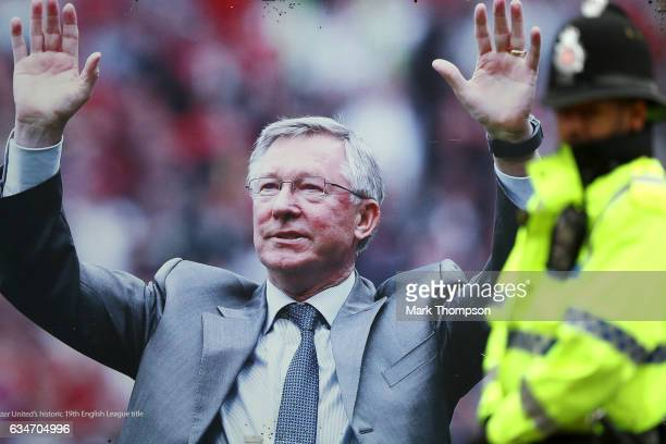 A police officer stands in front of the picture of former manager Alex Ferguson prior to the Premier League match between Manchester United and...