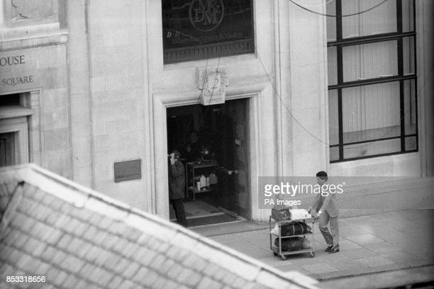 A police officer stands in the doorway of a building close to the besieged Libyan People's Bureau in St James's Square London armed with an automatic...
