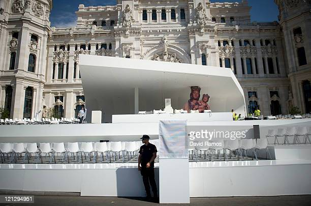 A police officer stands in the shade as he controls the security during the preaparations of the main stage at Cibeles Square ahead the visit of Pope...